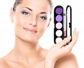 Beauty portrait of young, attractive, fresh, healthy and natural woman with the makeup pallet isolat
