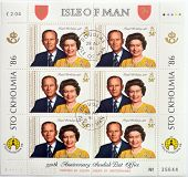 ISLE OF MAN - CIRCA 1986: Stamps printed in Isle of Man shows queen Elizabeth II and Prince Philip