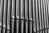 stock photo of pipe organ  - Organ Pipes Inside a Catholic Cathedral in Paris - JPG