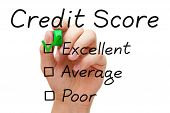 stock photo of summary  - Hand putting check mark with green marker on excellent credit score evaluation form - JPG