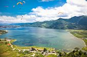 Paraglider flying over the  Fewa (Phewa) lake in Pokhara, Nepal.