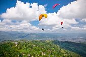 pic of parasailing  - Paraglider flying against the Himalayas  - JPG