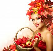 Beauty Autumn Woman with Ripe Red Organic Apples. Beautiful Fashion Model Girl with Autumnal Hairsty