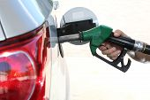 stock photo of petrol  - Petrol or gasoline being pumped into a motor vehicle car - JPG