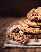 Chocolate Chip Cookies On Natural Linen Napkin On Wooden Background.  Pile Of Chocolate Chip Cookies