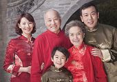 Multi-generation family portrait by traditional Chinese building