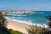 foto of st ives  - Porthminster beach St Ives Cornwall England with white waves and blue sea and sky on a beautiful summer day - JPG