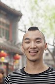 picture of mohawk  - Young man with mohawk haircut smiling looking at camera - JPG