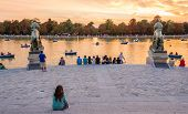 People watching sunset in Buen Retiro park Madrid