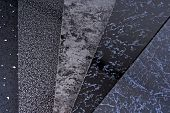 stock photo of tile cladding  - closeup of black pvc plastic cladding panel samples - JPG