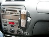 foto of hands-free  - Console of car showing mobile phone hands free car kit radio and controls - JPG