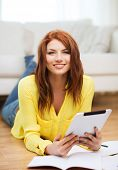 business, education and technology concept - smiling female student with notebooks and tablet pc com