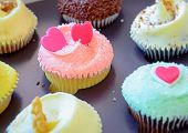 Assorted colorful cup cakes
