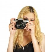 the young woman with camera isolated on white