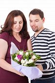 Happy Couple Unwrap A Bouquet Of Flowers