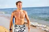 Surfer fun on summer beach - handsome man. Bodyboarding surfing good looking fit fitness model runni