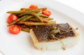 Cod fillet with runner beans and tomatoes