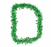 Green tinsel with stars in form of letter D.