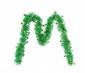 Green tinsel with stars in form of letter M.