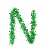 Green tinsel with stars in form of letter N.