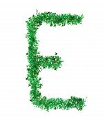 Green tinsel with stars in form of letter E.