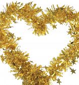 Christmas yellow tinsel. Arranged in form of heart