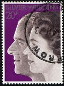 USA, circa 1974: Queen Elizabeth II and and Prince Philip on vintage postage stamp, circa 1974