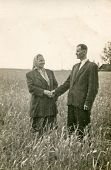 POLAND, CIRCA 1948: Vintage photo of happy couple in field