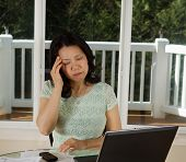 Mature Woman Showing Stress While Working From Home