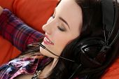 Lifestyle. Beautiful, happy woman in headphones