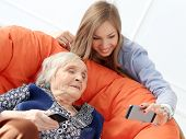 Elderly woman and beautiful granddaughter with wide smile