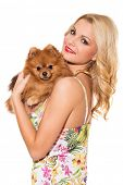 Vogue. Attractive girl with dog on a white background