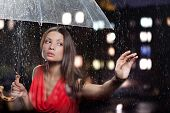 pretty woman with umbrella under
