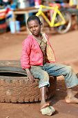 Barefoot  Boy, Resting, Sitting On Car Tire