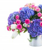 bouquet of white tulips, pink roses and blue hortensia flowers