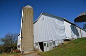 Large white barn and silo