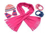 Pink and blue winter accessories isolated on white background.