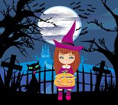 Girl In Witch Costume Holding Pumpkin With Candy