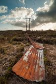 foto of boggy  - discarded rusty corrugated iron in a peat bog field in Ireland