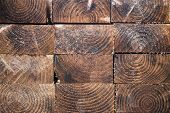 stock photo of 2x4  - Stack of wood planks textures piled up in lumber yard - JPG