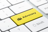 Law concept: Business People and Advocacy on computer keyboard background
