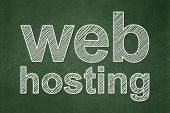 Web development concept: Web Hosting on chalkboard background