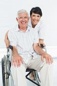 Portrait of a nurse with senior patient sitting in wheelchair at the hospital