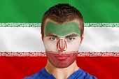 Composite image of serious young iran fan with facepaint against digitally generated iran national flag