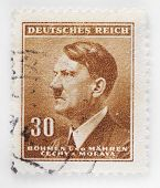 GERMANY - CIRCA 1942: A stamp printed in The Protectorate Czech and Moravia shows sepia portrait of Adolf Hitler, series, circa 1942