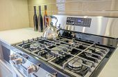 Stove closeup in modern kitchen interior with stainless steel gas cook-top