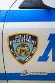 NEW YORK, US - NOVEMBER 22: Detail of door of New York Police car showing crest. November 22, 2013 i