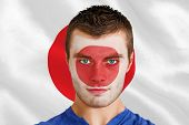 Composite image of serious young japan fan with facepaint against digitally generated japan national