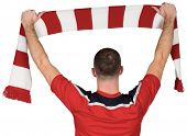 Football player holding striped scarf on white background