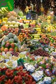 BARCELONA, SPAIN - JANUARY 9, 2013: Abundance of fruits on the farmer's market Mercat de Sant Josep